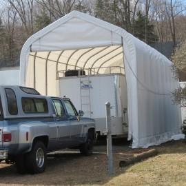 ShelterLogic 15W x 60L x 12H Peak 21.5oz White Portable Garage